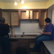 Joe and Vicky working on the tedious task of removing flat head screws.