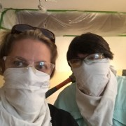 You can see the award-winning drop cloth taping job I did behind Vicky and I looking menacing.