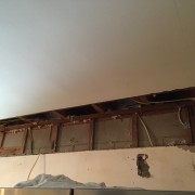 You can see the wall studs and the ceiling trusses here.  Unfortunately, you can also see the supporting wall where I want to put our window, so that meant a call to Elyse and a future visit from contractor Mark.