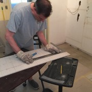 Robbie cutting the concrete board subfloor to go under the tile.