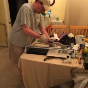 Robbie learned to cut tile for the first time!