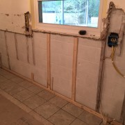 Concrete wall cleaned, scrubbed, and sealed.