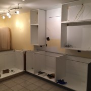 Upper cabinets on the opposite side are started.